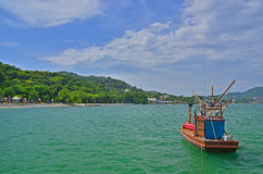 Le bateau et la mer Photographie stock