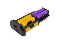 Le batterie AA dell'adattatore per la batteria trattano la macchina fotografica moderna di DSLR Fotografia Stock