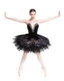 Le beau ballerine se tient en position de ballet de releve Photos stock