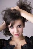 le beau brunette enroule le modèle de fille Photo stock