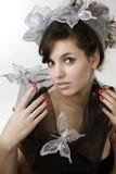 le beau brunette enroule le modèle de fille Photographie stock libre de droits