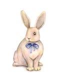 Le beau lapin d'aquarelle avec un arc bleu est sur un fond blanc Le dessin fantastique des enfants Travail manuel Photographie stock