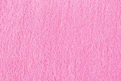 Le beau sable décoratif rose a dispersé sur la table Images libres de droits