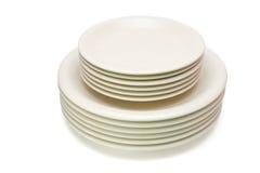 le beige plaque la pile de soucoupes Image stock