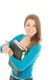 Le bel étudiant montre le pouce  photo libre de droits