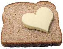 Le beurre aime le pain. photo stock