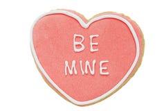 Le biscuit, biscuit en forme de coeur avec des mots de givrage soit le mien Photographie stock libre de droits