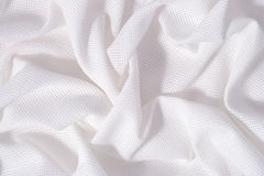 Le blanc a chiffonné la toile de coton pour la couture comme fond photographie stock