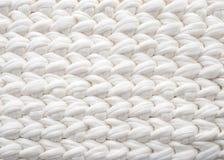 Le blanc de coton de plan rapproch? tricotent l'atmosph?re de couverture, chaude et confortable Tricotez le fond photos libres de droits