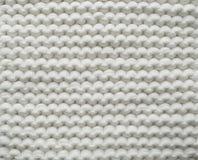 Le blanc de coton de plan rapproch? tricotent l'atmosph?re de couverture, chaude et confortable Tricotez le fond image stock