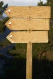 Le blanc en bois de panneau-réclame ajoutent votre texte Photo stock