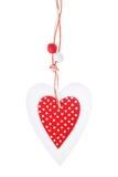 Le blanc et le rouge ont cousu le coeur de Noël sur le fond blanc, pour le jour du ` s de Valentine de salutations Photos libres de droits