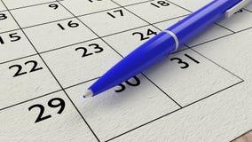 Le bleu ballpen sur un plan rapproché de papier de calendrier Images libres de droits
