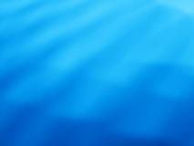 Le bleu diagonal ondule le fond de bokeh Photo stock