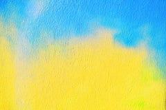 Le bleu et le jaune ont peint le mur, fond abstrait photo libre de droits