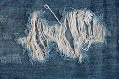 Le bleu texturisé rayé a employé le fond de toile de vintage de denim de jeans Photos stock