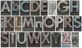 le bloc d'isolement marque avec des lettres le blanc Photographie stock