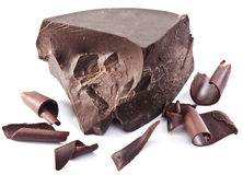 Le bloc et les puces de chocolat s'approchent de lui Images libres de droits