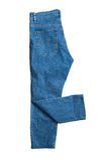 Le blue jeans si chiudono in su su bianco Immagini Stock