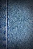 Le blue jeans strutturano, priorità bassa vignetted Immagini Stock