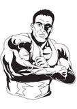 Le Bodybuilder a plié ses mains sur son coffre Photographie stock libre de droits