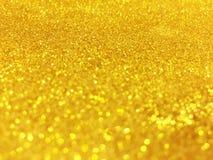 Le bokeh abstrait d'or entoure pour le fond de Noël, Li de scintillement Images libres de droits