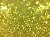 Le bokeh abstrait d'or entoure pour le fond de Noël, Li de scintillement Photographie stock