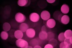 Le bokeh rose soustraient le fond noir clair photo stock