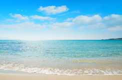 Le Bombarde beach foreshore on a clear day Royalty Free Stock Photos