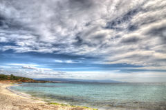 Le Bombarde beach foreshore on a cloudy day in hdr Royalty Free Stock Photography