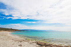 Le Bombarde beach under a cloudy sky in springtime Royalty Free Stock Image