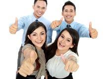 Le bon travail, gens d'affaires avec des pouces vers le haut photos stock