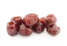 Le bonbon a séché le jujube ou les dates rouges sur le fond blanc Image libre de droits