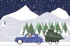 Le bonhomme de neige conduit dans une rétro voiture sur une route d'hiver Photographie stock libre de droits
