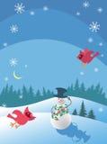 Le bonhomme de neige et les cardinaux Photos stock