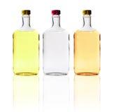Le bottiglie dell'alcool hanno isolato Fotografia Stock Libera da Diritti