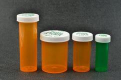 Le bottiglie della medicina con il bambino rendono impermeabile le protezioni Fotografia Stock Libera da Diritti