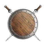Le bouclier et deux épées de vieux Vikings en bois d'isolement image stock