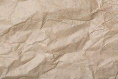 Le brun abstrait réutilisent le papier chiffonné pour le fond le papier donne au fond une consistance rugueuse Photo stock