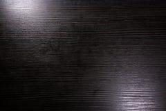 Le bureau noir met en lumière l'éclair en bois de texture de fond d'espace de travail Photographie stock