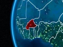 Le Burkina Faso sur terre la nuit Image libre de droits