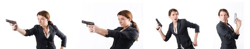 Le businewoman de femme avec l'arme à feu de main Images libres de droits