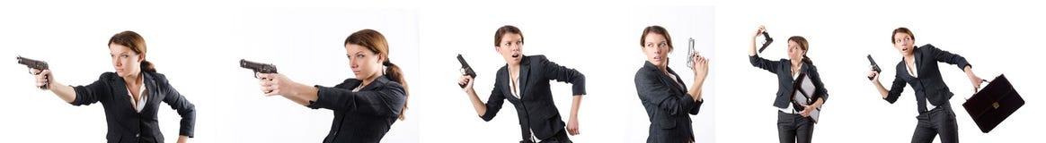 Le businewoman de femme avec l'arme à feu de main Photographie stock