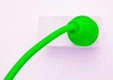 Le câble se connecte au pouvoir vert Photographie stock