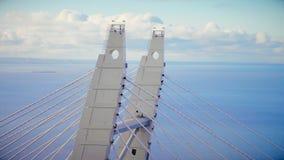 Le câble supérieur de structure métallique est resté le pont au-dessus de la mer sur le ciel nuageux de fond banque de vidéos