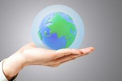 Le cache en verre de sphère sauvent le monde Photographie stock libre de droits