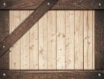 Le cadre en bois de Brown a vissé sur les planches légères de mur Photos libres de droits