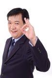 Le cadre supérieur, milieu a vieilli le Président montrant le geste correct de signe de main Image libre de droits