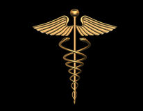 Le caducée médical signent dedans l'or Photo libre de droits