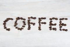 Le café de mot fait de grains de café photo stock